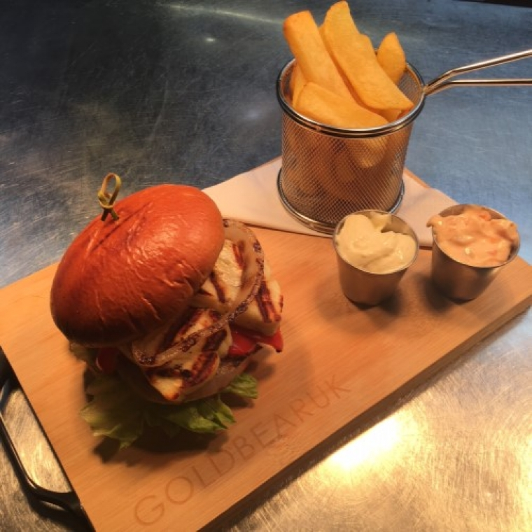 Halloumi burger served with chips and sauces