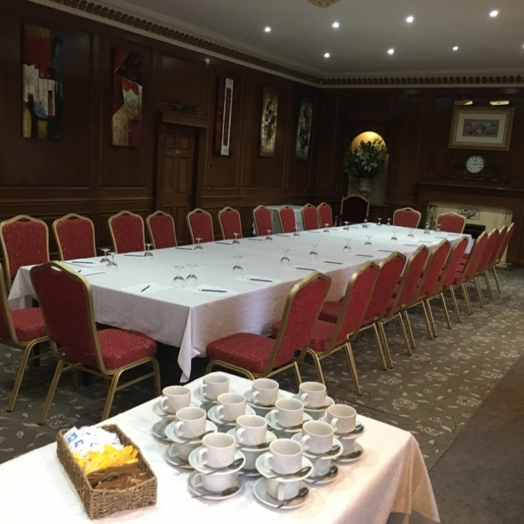 Penthouse Room at the Durrant House Hotel set up for a formal meal