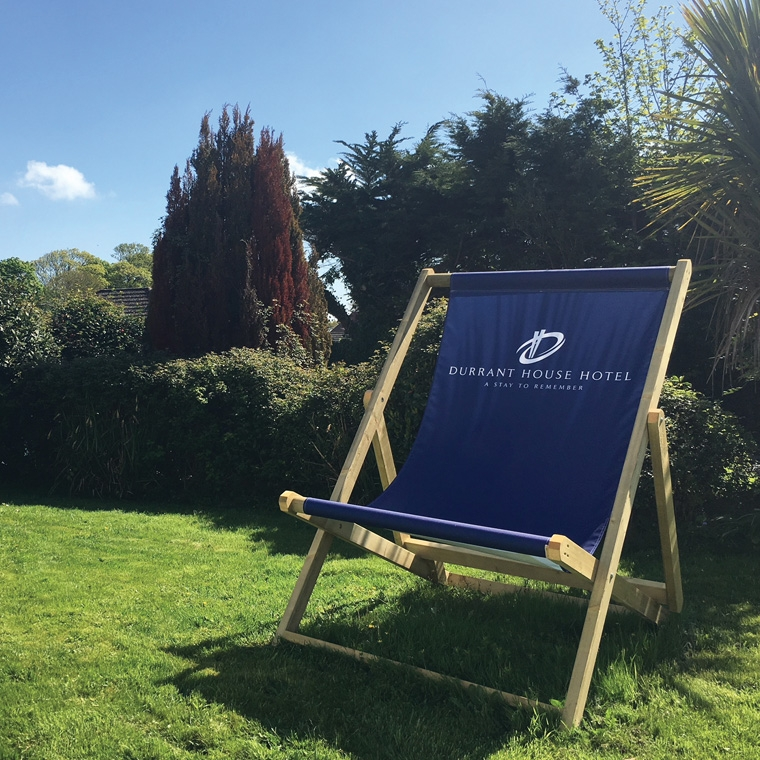 Durrant House Hotel Giant Blue Deck Chair located on the Durrant House Hotel's grass area